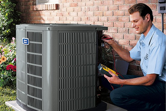Dealer service technician servicing an air conditioner